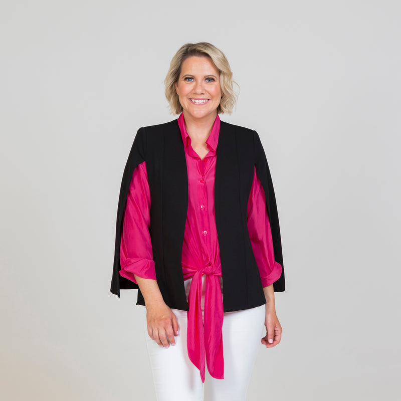 Kirsten cape - black, paired with a pink long sleeve top and white jeans