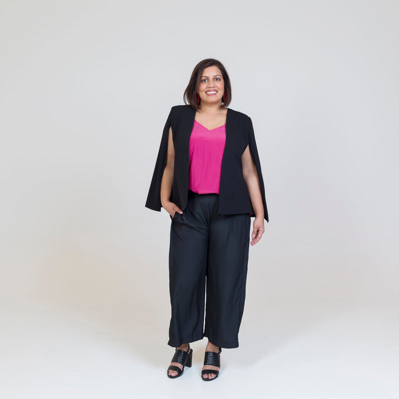 Kirsten cape - black paired with a pink top, our Maddy technical pants in black and black sandals