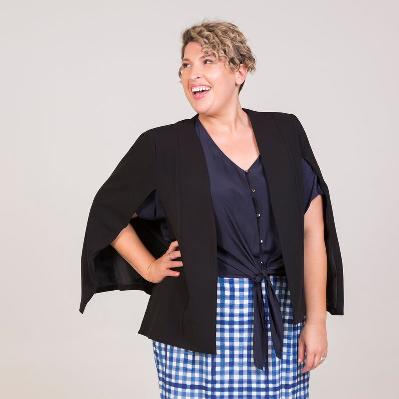 Kirsten cape - black paired with our Cate technical shirt - navy, and a gingham print skirt