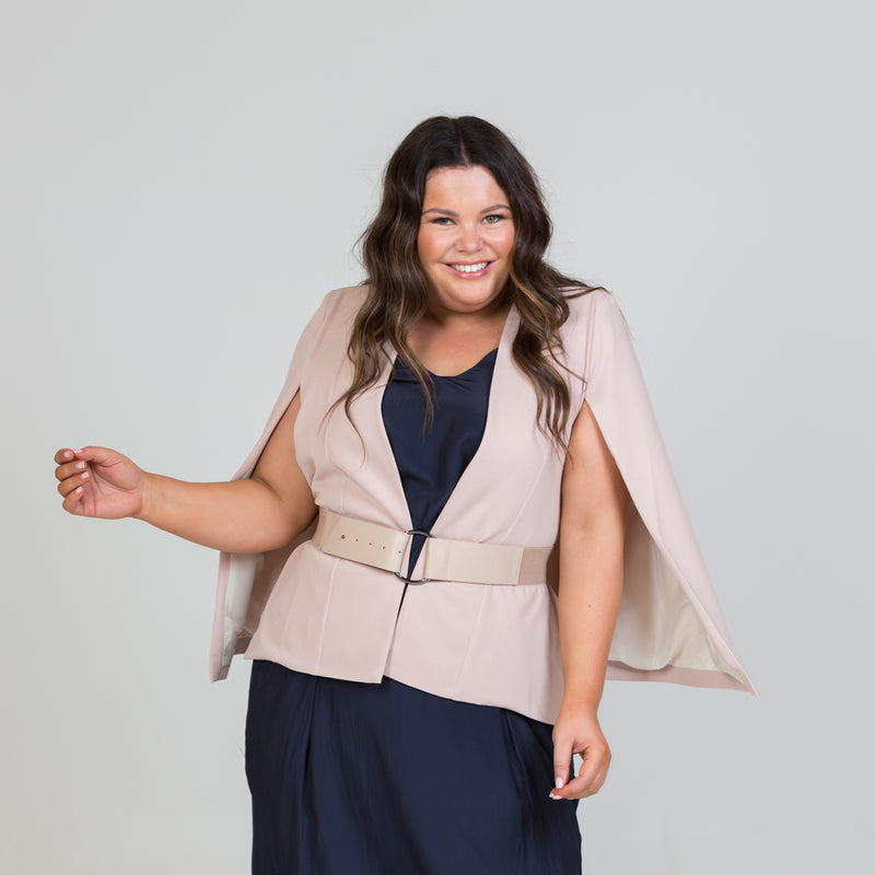 Kirsten cape - blush paired with a navy dress, and a nude belt