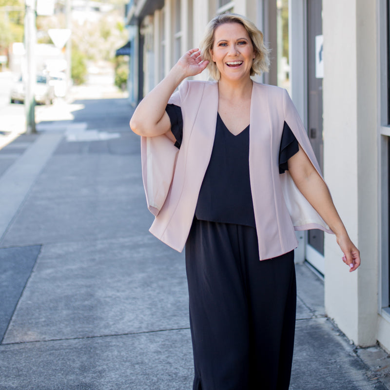 Kirsten cape - blush paired with our Barbara jumpsuit - black