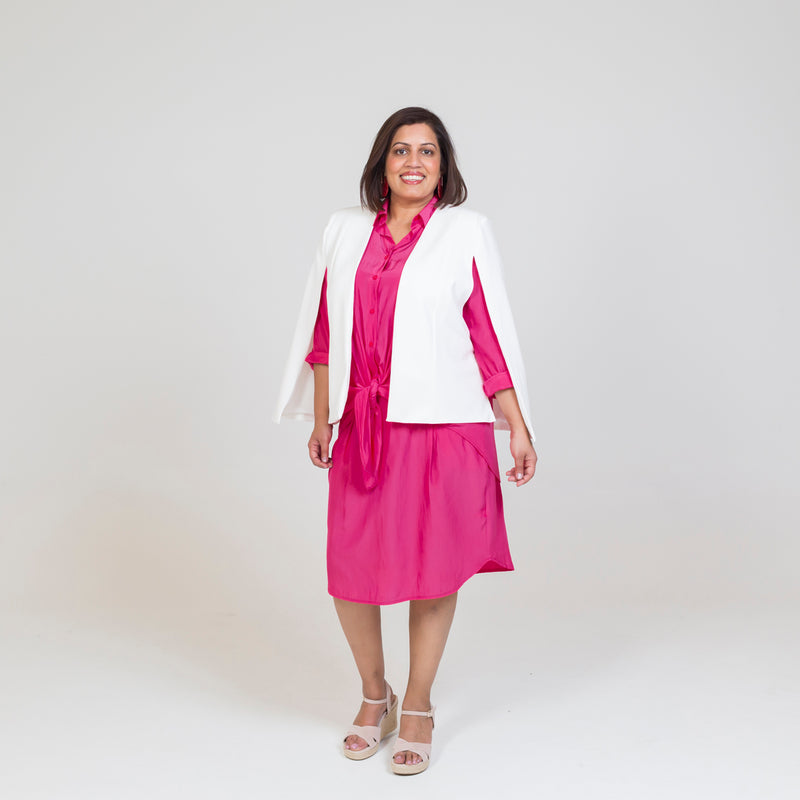 Kirsten cape - ivory paired with our Cate technical shirt in raspberry, a pink skirt and nude heels