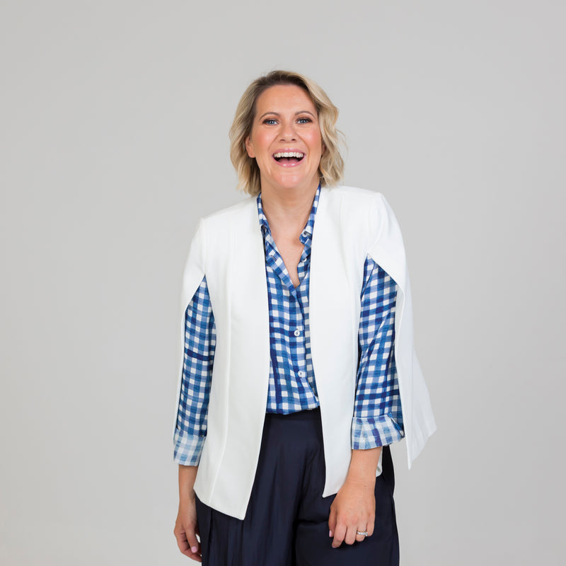 Kirsten cape - ivory paired with our Kimba shirt in gingham, and our Maddy technical pants in navy