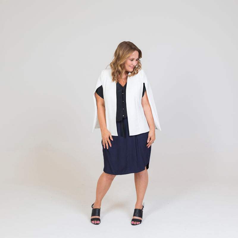 Kirsten cape - ivory paired with a black blouse a navy skirt and black heels