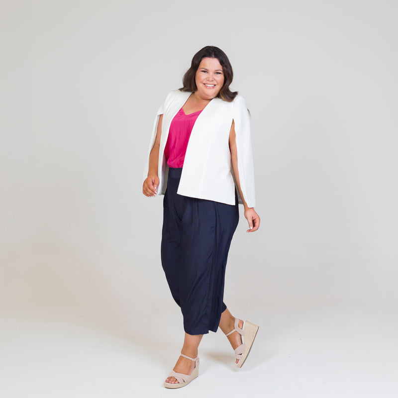 Kirsten cape - ivory paired with a pink cami, our Maddy technical Pant in navy and nude heels