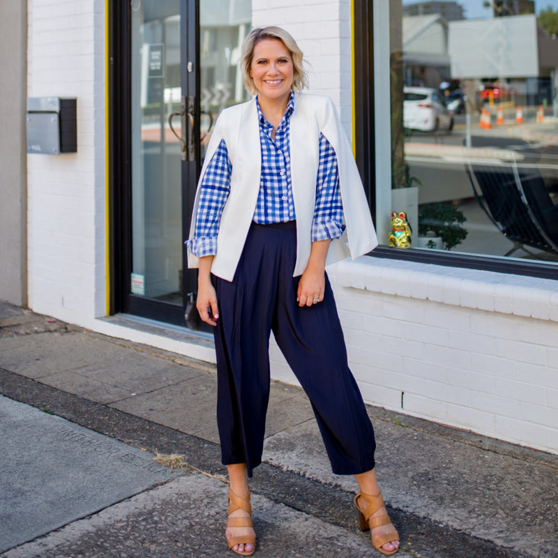 Kirsten cape - ivory paired with our Kimba shirt in gingham, our Maddy technical pants in navy and nude heels