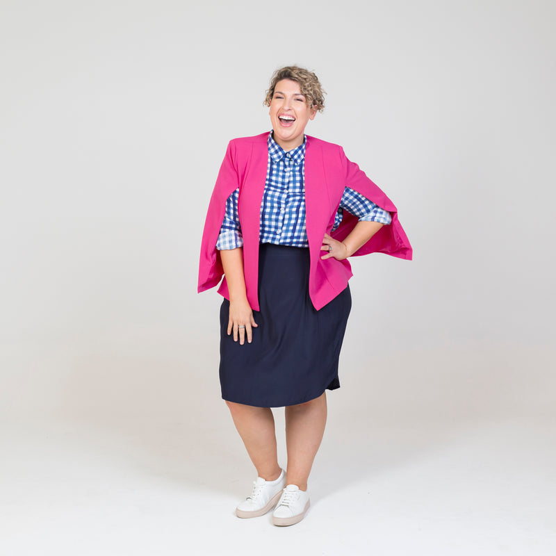 Kirsten cape - paris pink paired with our Kimba shirt in Gingham, a navy skirt and white sneakers