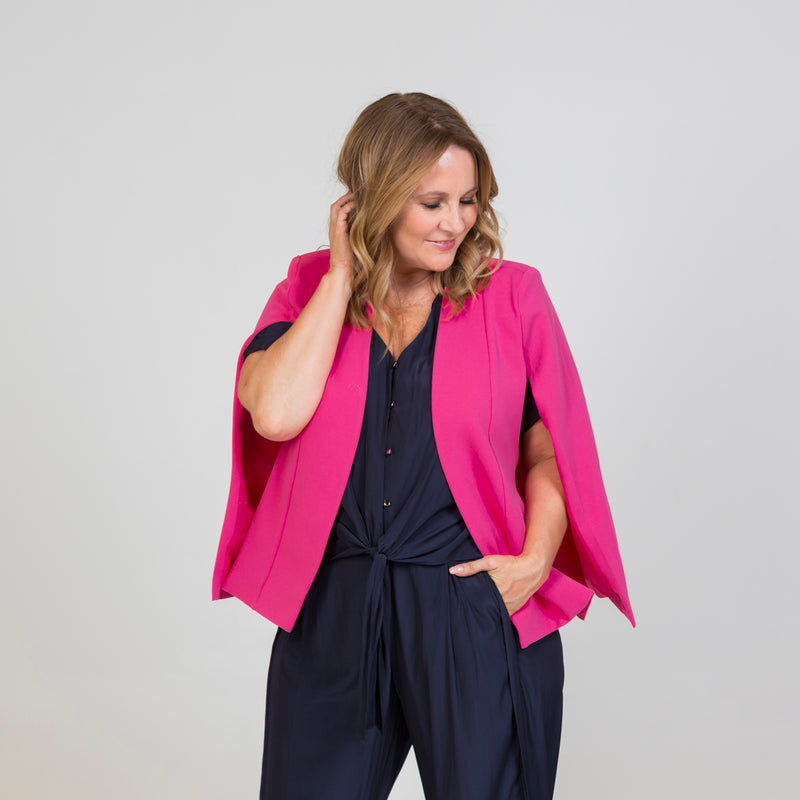 Kirsten cape - paris pink paired with a navy blouse, and our Maddy technical pant in navy
