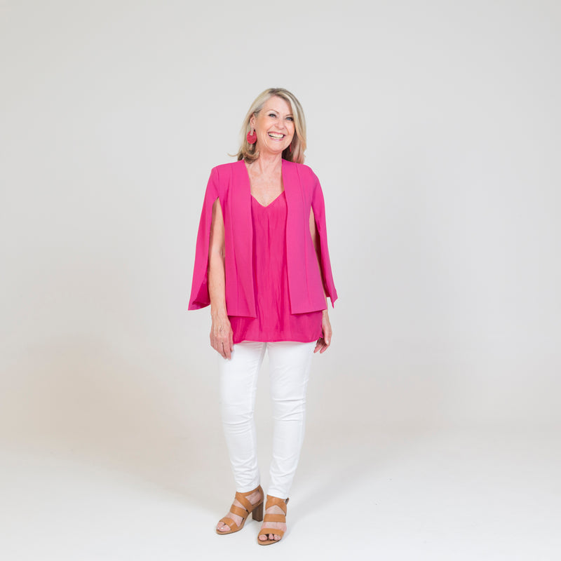 Kirsten cape - paris pink paired with our Rachel cami in Raspberry, white jeans and brown heels