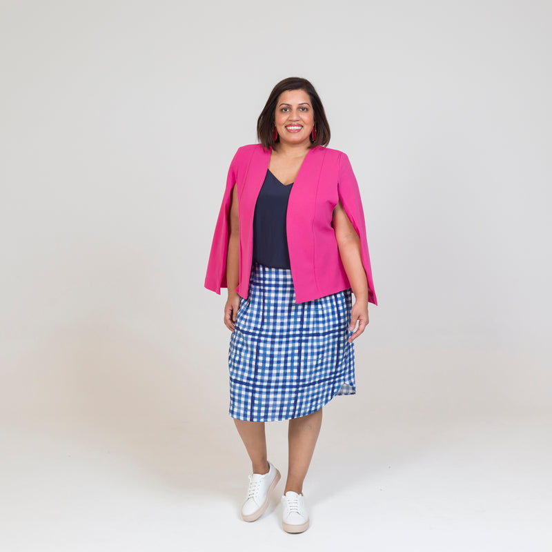 Kirsten cape - paris pink paired with our Rachel Cami in Navy, a gingham print skirt and white sneakers