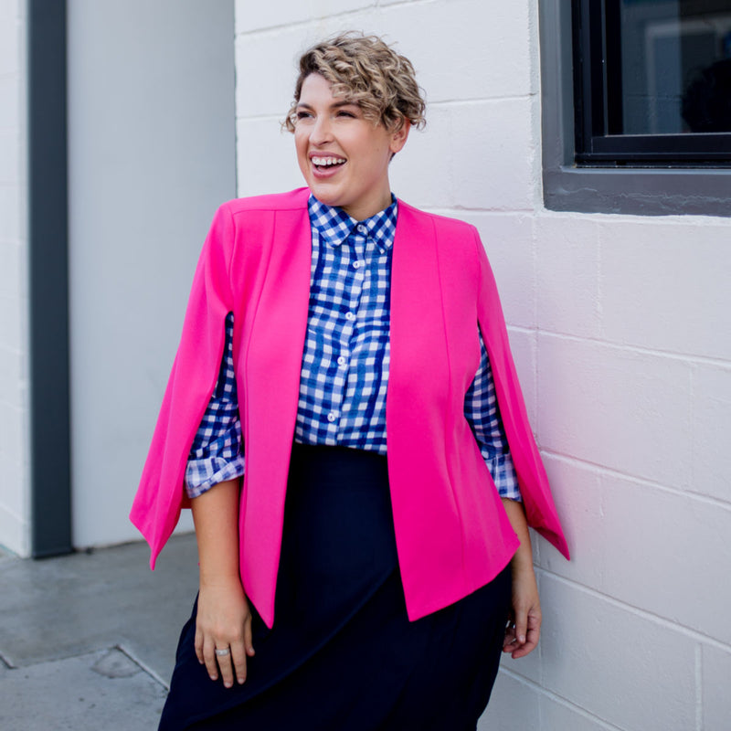 Kirsten cape - paris pink paired with our Kimba shirt in Gingham and a navy skirt