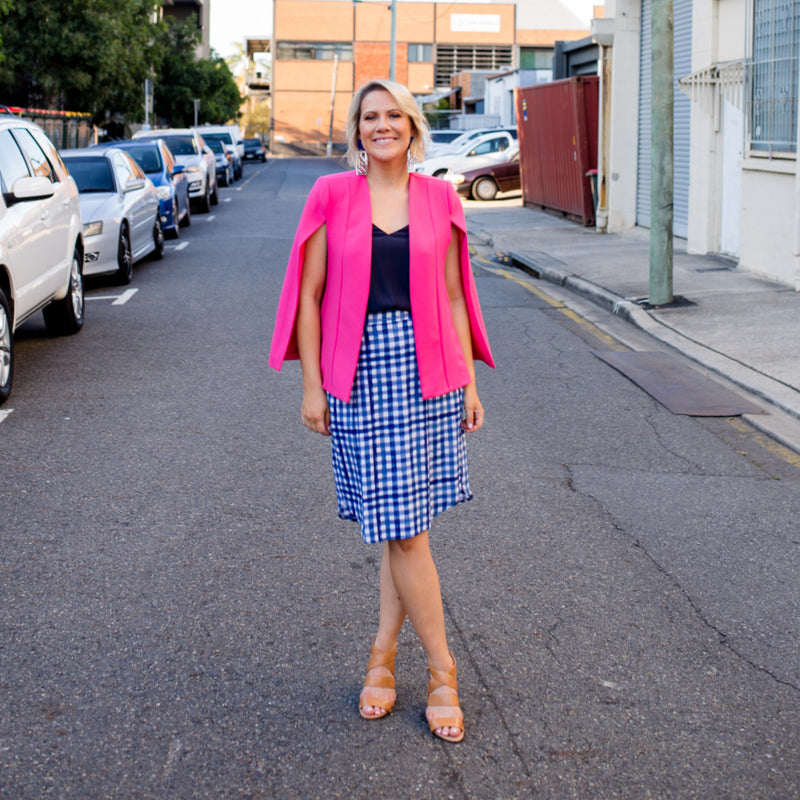 Kirsten cape - paris pink paired with our Rachel cami in navy, a gingham print skirt and brown heels