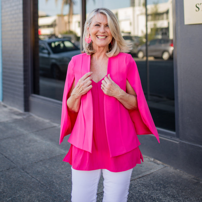 Kirsten cape - paris pink paired with our Rachel cami in Raspberry and white jeans