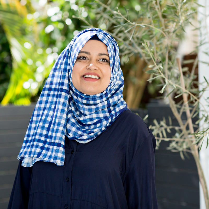 Faaiza wearing our Emily scarf/wrap in gingham and our Danielle technical shirt dress in navy