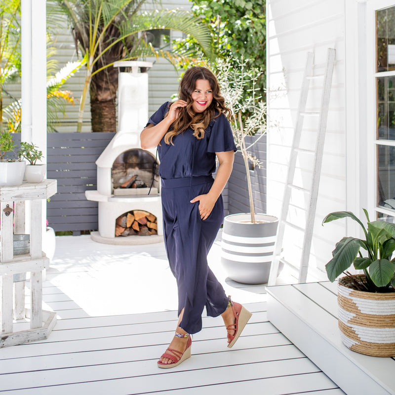 Stacey wearing wearing our Kim technical blouse in navy with our Navy maria pants to create the look of a jumpsuit.