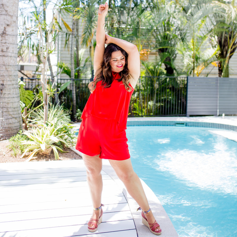 Stace wearing our Red Sonia playsuit with red wedges