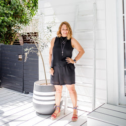 Karen wearing our Sonia playsuit in black with red heels.