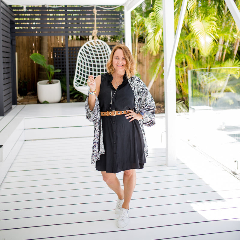 Karen wearing our Krista safari print duster over our Katy sleeveless shirt dress in black
