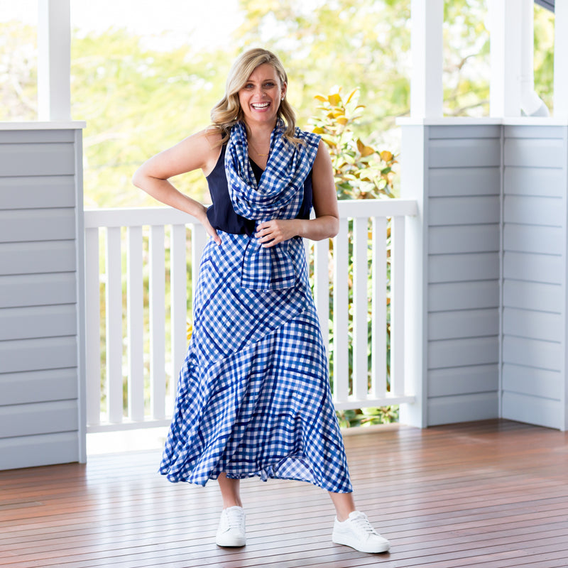Brooke in our Emily scarf/wrap gingham our Rachel techincal cami navy and our Ashlee midi skirt gingham paired with white sneakers