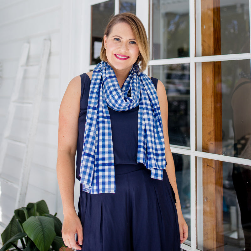 Bec wearing our Bec technical shorts navy, our Rachel technical cami navy and our Emily scarf/wrap gingham