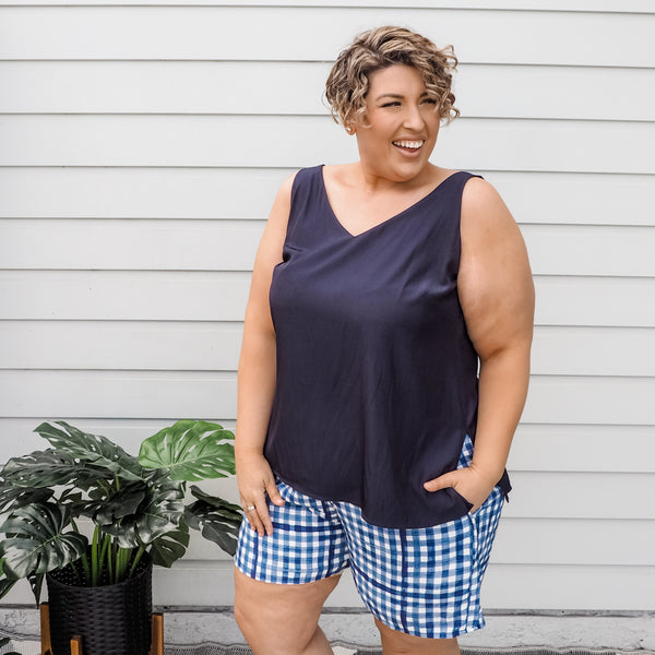 Jo wearing our Rachel technical cami in navy and our grace shorts in gingham