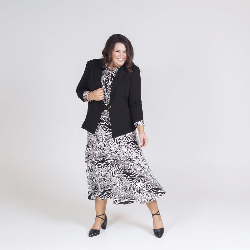 Kerryn blazer black with Sally shirt safari and Rylee midi skirt safari. Worn with a belt and black heels.
