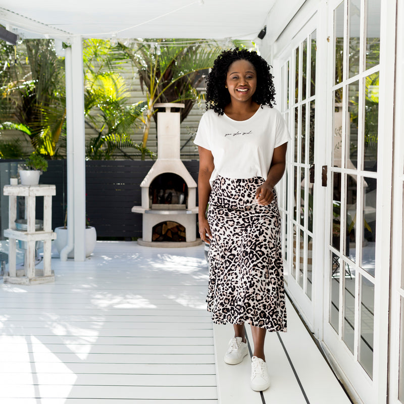 Sonia wearing our  Kutira midi skirt - animal print with our  Tanya relaxed tee - white and white sneakers