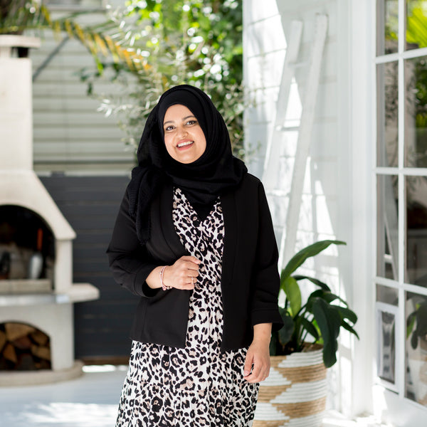 Faaiza wearing our Karen scuba jacket - black with our Whitney midi dress - animal print