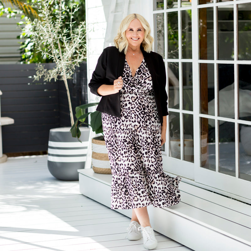 Nikki in our Whitney midi dress - animal print and our Karen scuba jacket - black paired with white sneakers