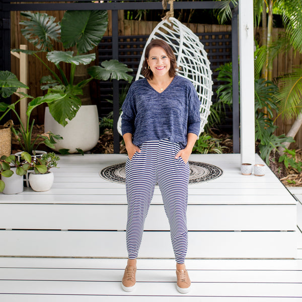 Bec wearing our Belinda striped joggy pants with our navy marl Jenny knit. She has styled this look with brown sneakers.