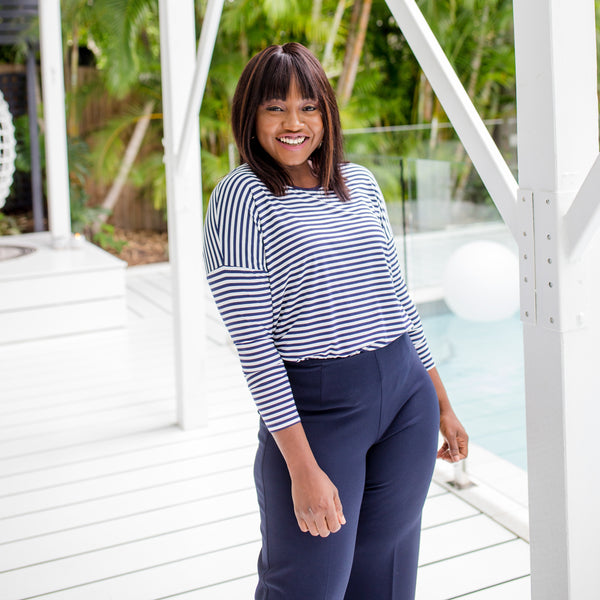 Sonia wearing our Steph long-sleeve relaxed tee in navy stripe  tucked into our navy Laura wide-leg pants.