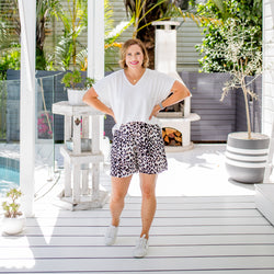 Bec wearing our white Alexa tee with our Gillian animal print shorts and white sneakers.