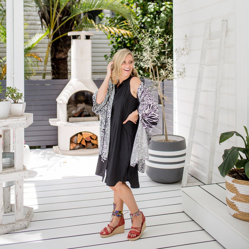 Brooke wearing our Krista duster in safari over our black Katy technical sleeveless shirt-dress