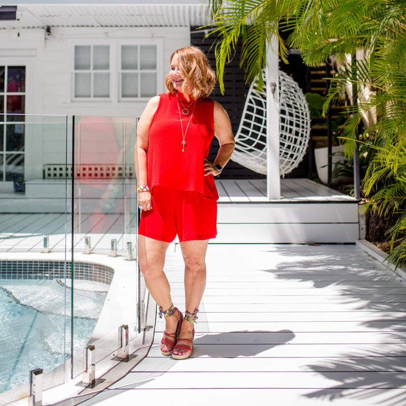 Karen wearing our Red Sonia playsuit with red wedges