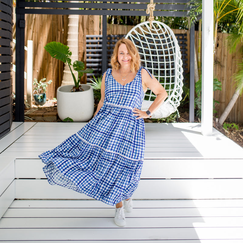 Karen wearing our Vanessa tie-shoulder dress in gingham with white sneakers
