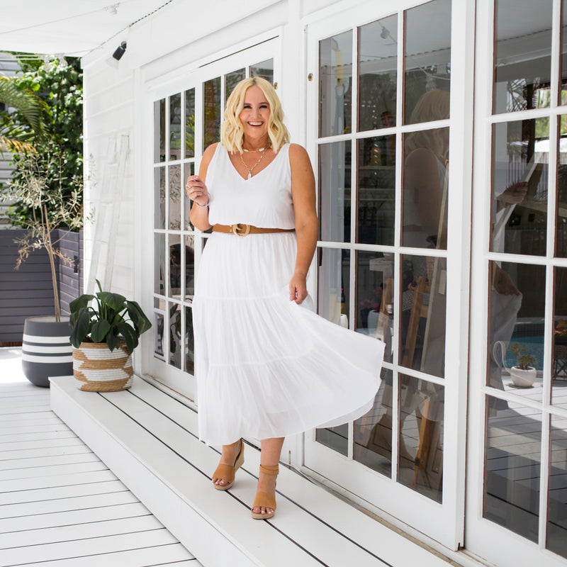 Nikki wearing our Rachael technical cami in white with our Sophie tiered maxi skirt in white.