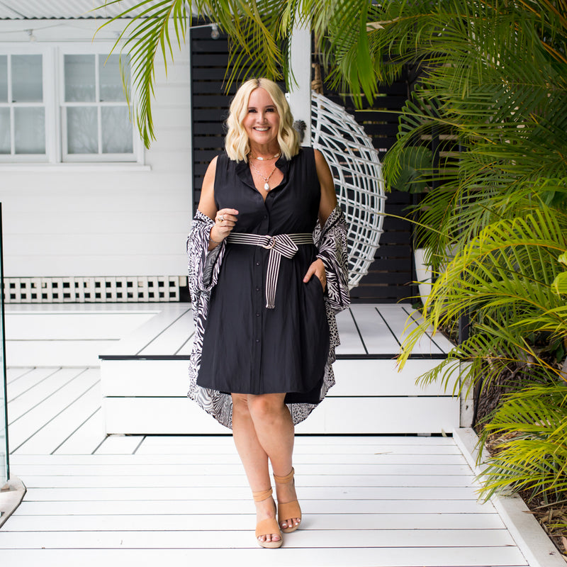 Nikki wearing our Krista duster in safari over our Katy sleeveless shirt dress in black