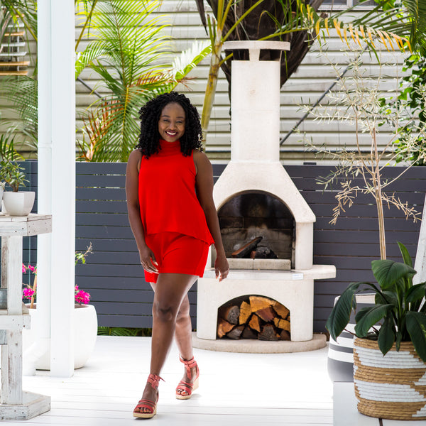 Sonia wearing our Red Sonia playsuit with red heels.