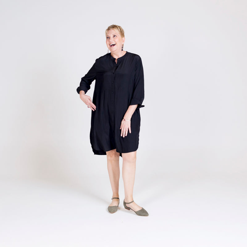 Danielle technical shirt dress black, styled with flat shoes.