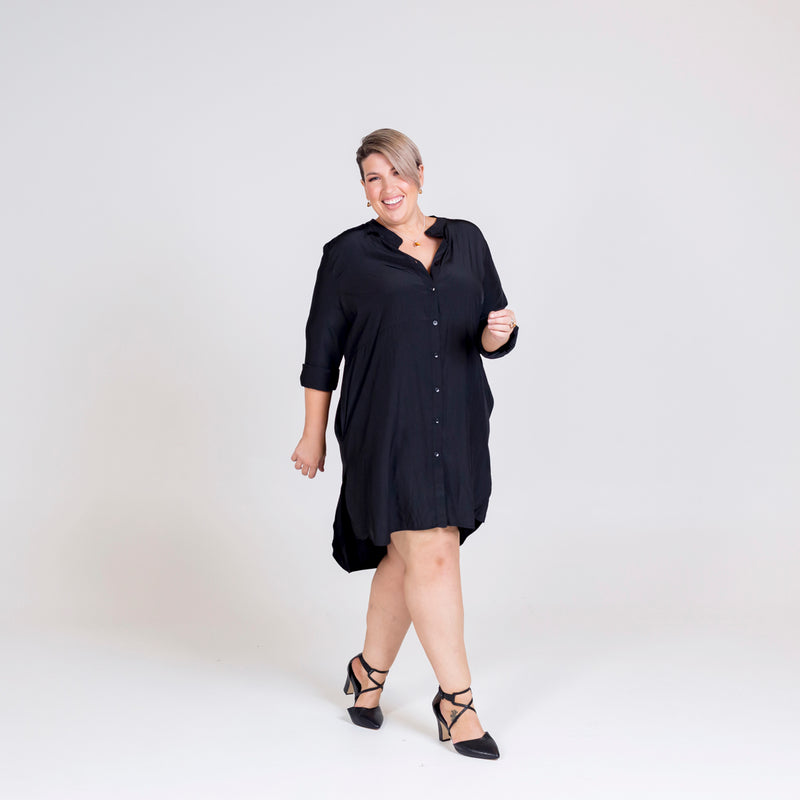 Danielle technical shirt dress in black, styled with black strappy heels.