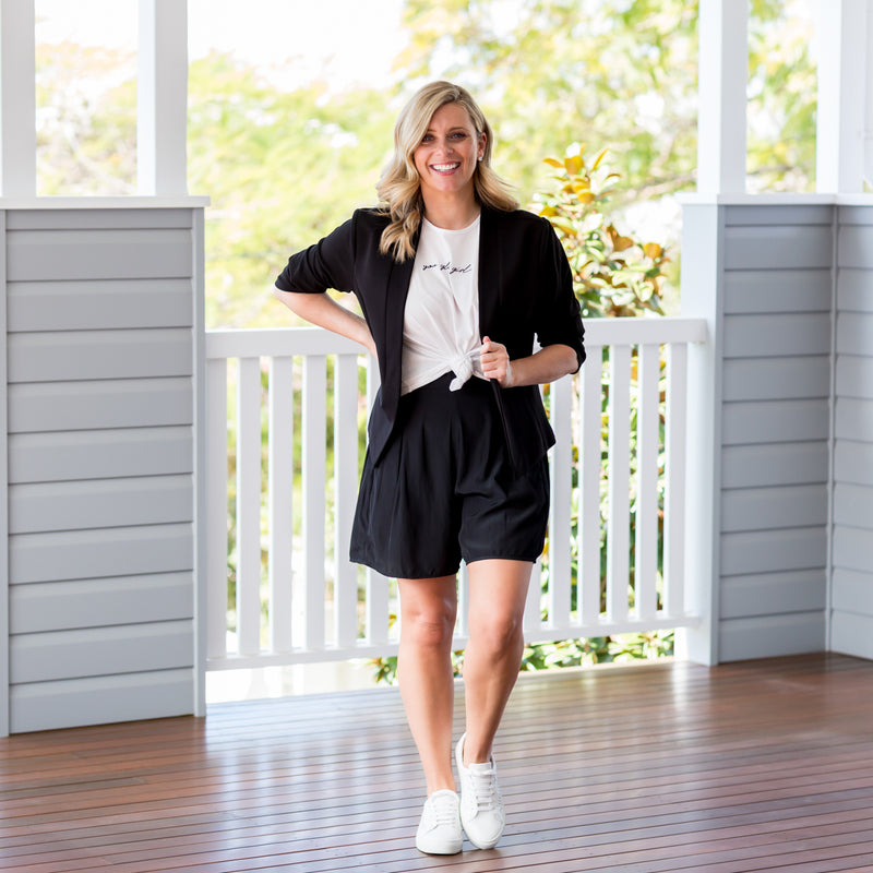 Brooke wearing our  Karen scuba jacket - black with our  Bec technical shorts - black, Tanya relaxed tee - white and white sneakers
