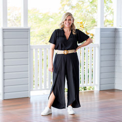Brooke wearing our  Maria technical split pant - black with our  Kim technical blouse - black, white sneakers and a belt