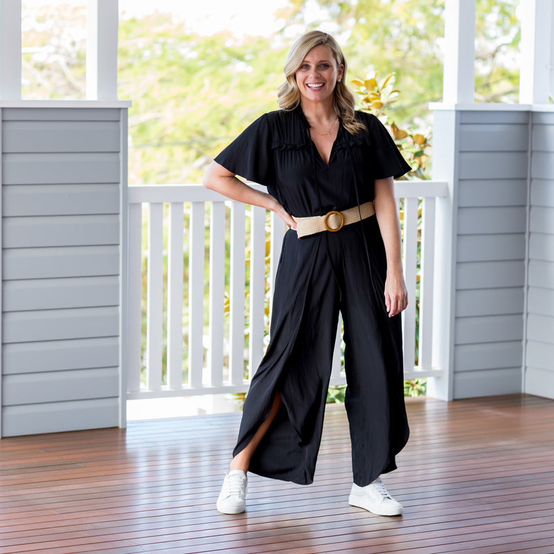 Brooke wearing our Kim technical blouse - black with our  Maria technical split pant - black,  white sneaker and a belts