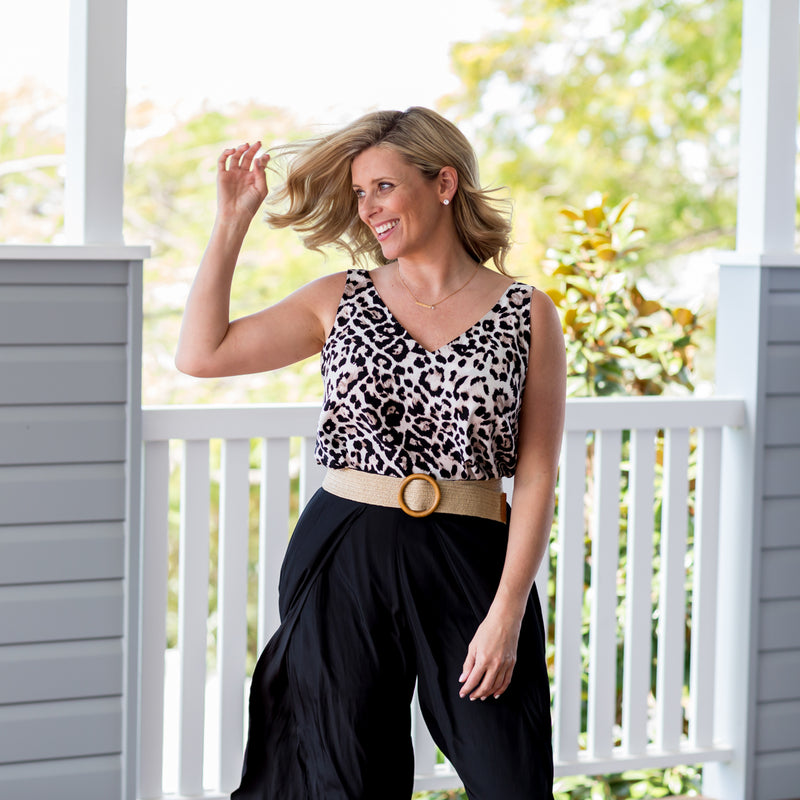 Brooke wearing our Brooke cami - animal print tucked into our Maria technical split pant - black with a belt