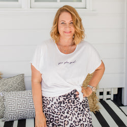 Karen in our Tanya relaxed tee - white and our Kutira midi skirt - animal print
