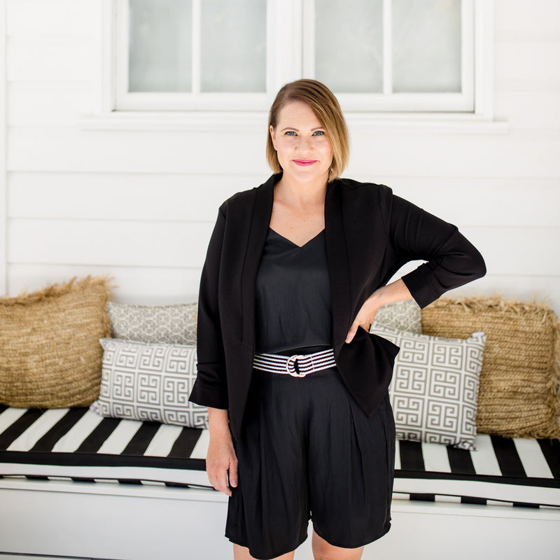 Bec wearing our Karen scuba jacket - black with our  Bec technical shorts - black, Rachael technical cami - black, and a belt