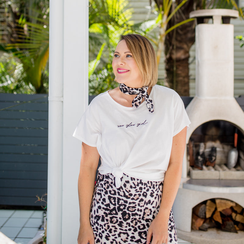 Bec wearing our  Nik scarf/wrap - animal print around her head with our Tanya relaxed tee - white and our Kutira midi skirt - animal print