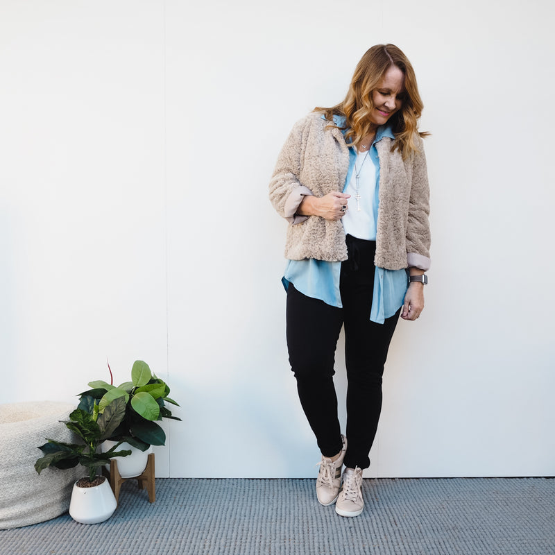 Renee faux fur jacket champagne worn over Sharon relaxed long sleeve tee white, Nadine chambray shirt (open), Suzie ponte jogger pant black and sneakers.