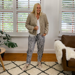 Renee faux fur jacket champagne worn over Sharon relaxed long sleeve tee white, with Melissa relaxed pant safari and sneakers.