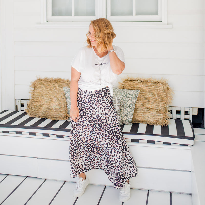 Karen wearing our Kutira midi skirt - animal print with our Tanya relaxed tee - white with white sneakers